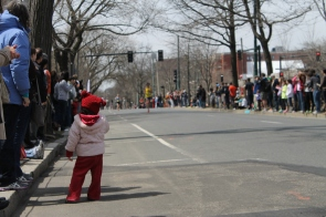 A child watches the Boston Marathon the morning of April 15, 2013.
